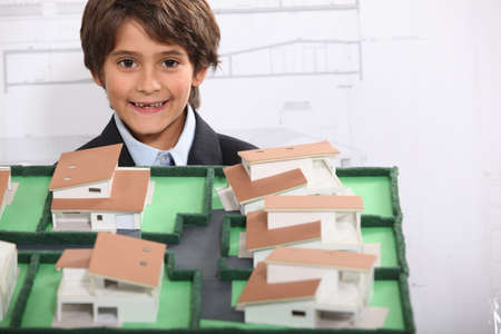 Little boy pretending to be architect photo