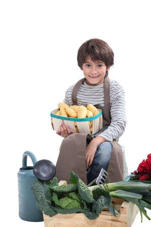 make belief: Little boy pretending to be a gardener Stock Photo