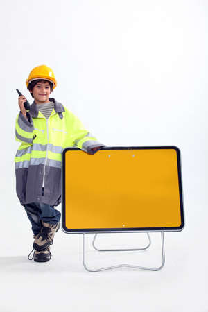 make belief: Boy dressed up as a traffic guard