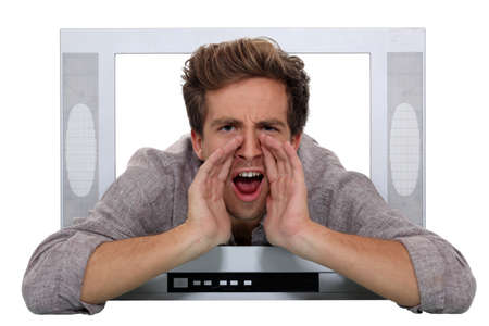 A man shouting through a TV. photo