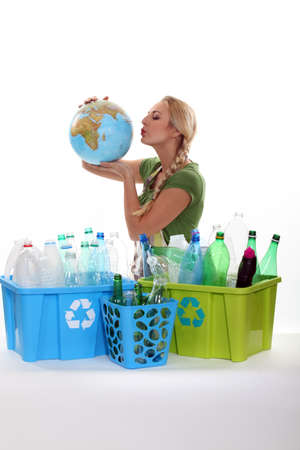 reprocess: Woman holding globe recycling bottles