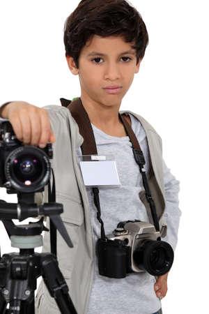 stock photograph: Young boy as a press photographer Stock Photo