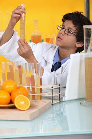 orange industry: little boy in a lab