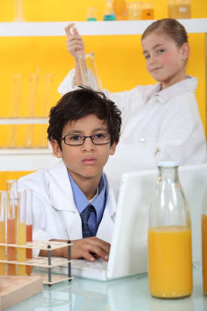 essays: Children in the laboratory Stock Photo