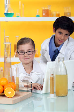 Kids conducting an experiment on oranges photo