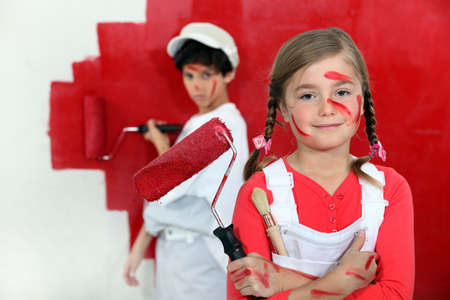 resent: Children painting a wall red