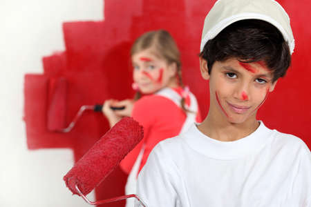 Children painting a room red Stock Photo - 13867589