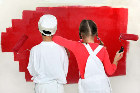 Children painting a wall photo
