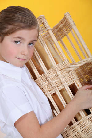 Girl with basket of bread Stock Photo - 13867623