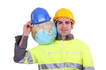 evoking: Worker with globe on his shoulder Stock Photo