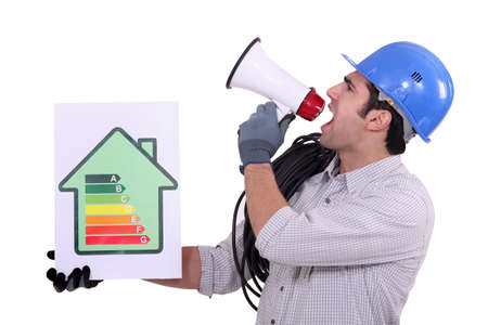 Construction worker promoting energy savings. photo