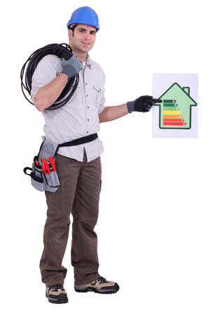 norms: Electrician with a house energy rating sign Stock Photo