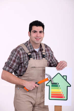Man with an energy rating symbol Stock Photo - 13868797