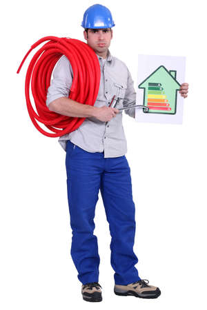 Electrician holding energy rating placard photo