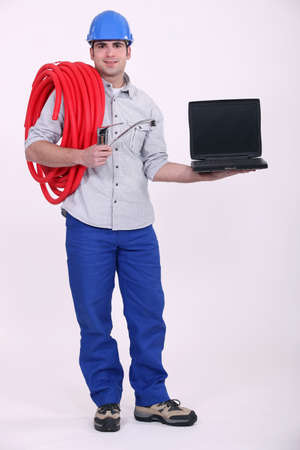 plumber holding a laptop photo