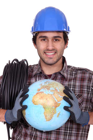 Electrician with a globe in his hands photo