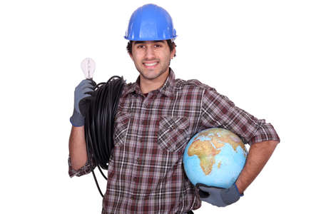 Eager electrician installing electrical systems abroad photo