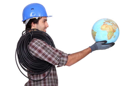 Electrician holding a globe Stock Photo