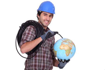 An electrician plugging a wire in a globe. photo