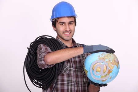 Electrician holding globe photo