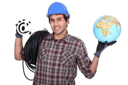 Electrician holding globe and at symbol photo