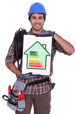 Electrician with an energy rating card Stock Photo - 13868402