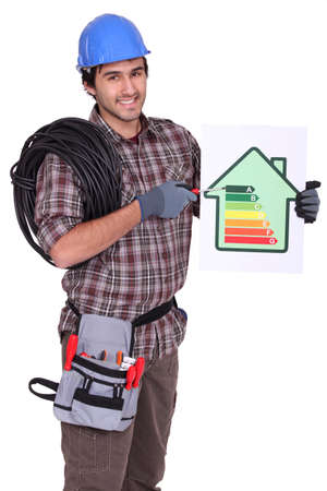 energy efficient: Tradesman pointing to an energy efficiency rating chart