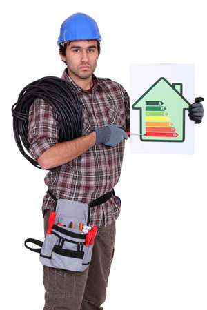 Electrician pointing to energy rating poster Stock Photo - 13868659