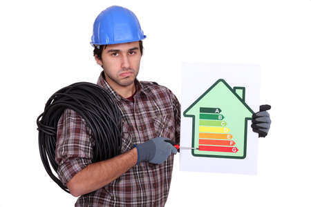kwh: Electrician holding energy-rating information