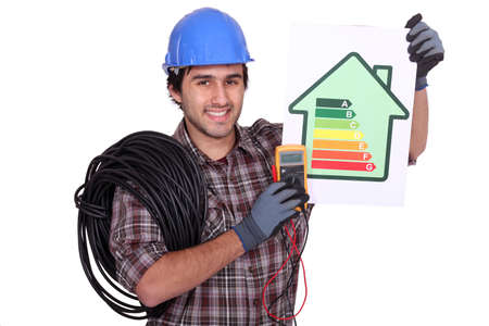electrician holding an energy consumption label photo