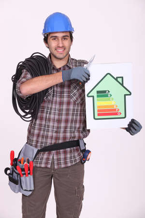 craftsman holding an energy consumption label photo
