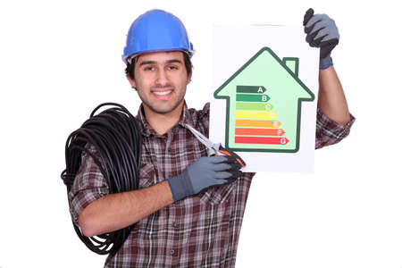 classify: electrician holding an energy consumption label