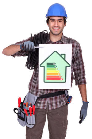 Electrician holding energy information board photo