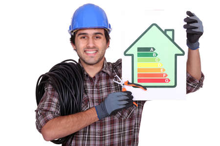 Electrician with an energy rating card Stock Photo - 13868467