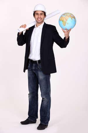 Architect holding globe photo