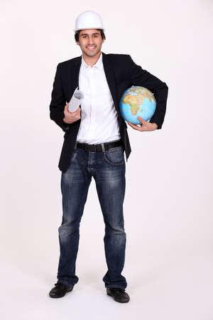 An architect holding a globe. photo