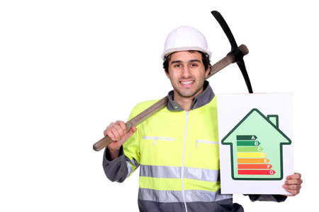 Man with pick-axe and energy rating panel photo