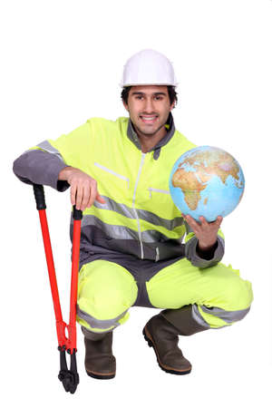 Worker with boltcutters and a globe photo