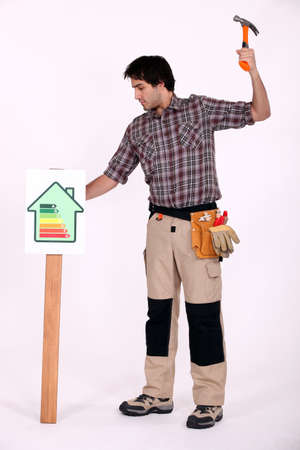 2x4 wood: Man hamering post into ground Stock Photo
