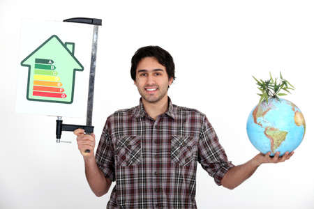 Man holding a globe and an energy efficiency rating chart photo