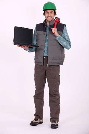 Laborer carrying a laptop computer Stock Photo - 13868470