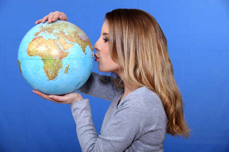 Woman kissing a globe photo