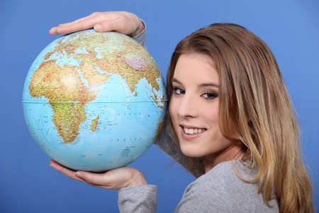 Attractive woman holding a globe photo