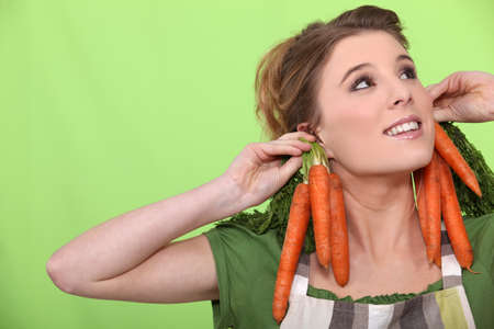 aberrant: a female cook wearing carrots as earrings