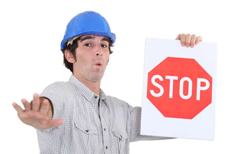 Worker holding a red stop sign photo