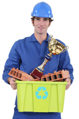 Builder with an award for recycling material photo