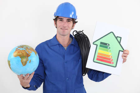Electrician with a globe and an energy rating sign photo