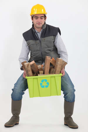 Man carrying box of recyclable wood photo