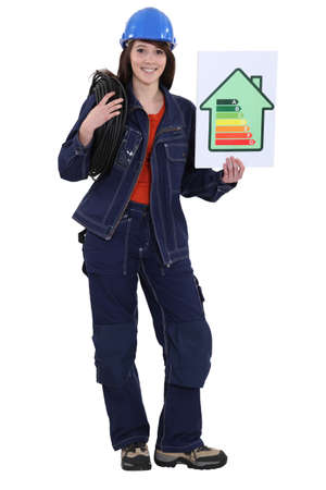craftswoman holding an energy consumption label photo