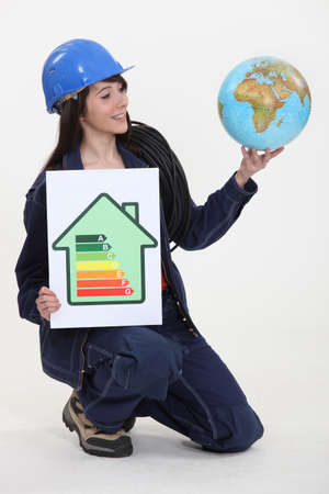 A female electrician promoting energy savings. photo